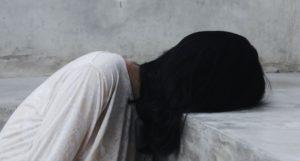 woman in a reading slump or book hangover