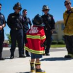 child pretending to be a firefighter