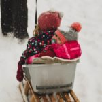 children in a sled in the snow
