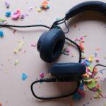 a set of back headphones surrounded by rainbow colored confetti https://unsplash.com/photos/zm42KtKcn9c