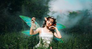 woman dressed as a fairy in a meadow