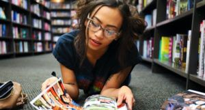 young woman reading comics feature