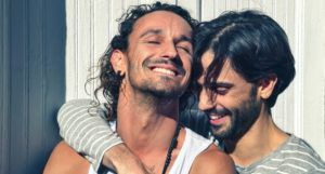 gay men smiling and embracing