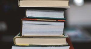 image of a stack of books https://unsplash.com/photos/MiJTU6lqksg