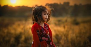 little girl outdoors in nature