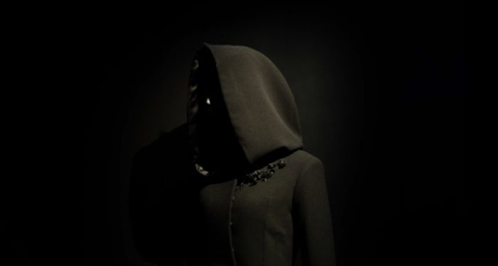 image of a person wearing a black hoodie against a black background https://unsplash.com/photos/uGBIhxZ4zoE
