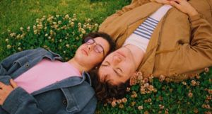 gay couple in a field of flowers