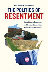 Pictured Book cover of The Politics of Resentment featuresa barn in rural Wisconsin