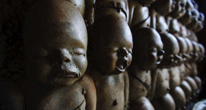creepy dolls in a row
