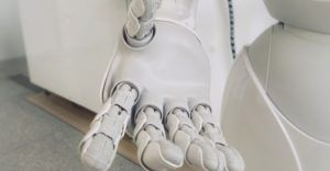 robot with its hand outstretched for robots and AI feature