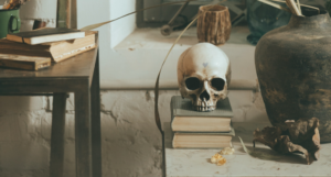 skull on stack of books for supernatural books for halloween