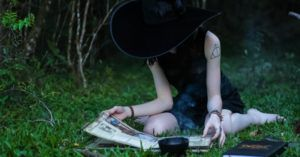 witch reading a book about witchcraft