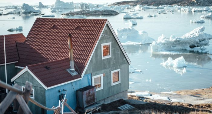 house near icy coast in greenland
