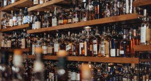 image of bottles of spirits at a hotel bar https://unsplash.com/photos/6UIonphZA5o