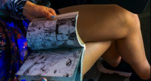 image of a woman sitting and reading a comic book https://www.pexels.com/photo/woman-sitting-and-reading-comic-book-5266499/