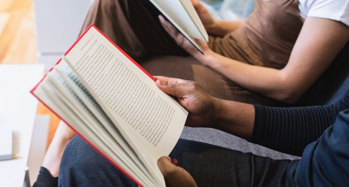 people reading together for book club