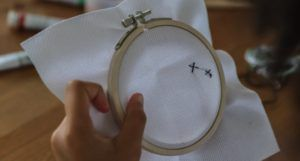 image of an embroidery hoop and fabric https://www.pexels.com/photo/diverse-children-doing-embroidery-and-painting-5063578/