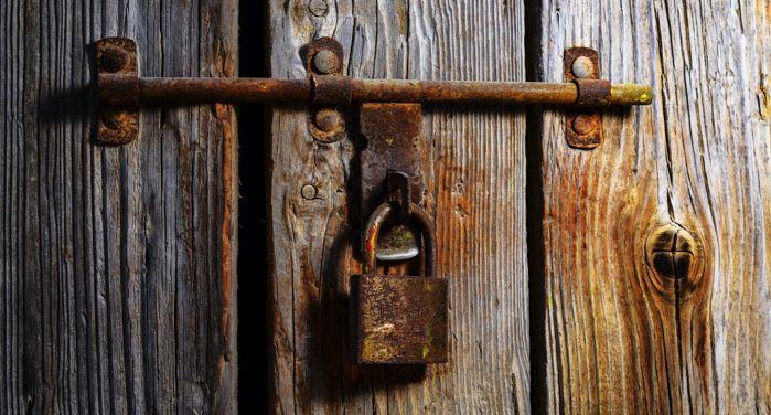 image of a brown padlock on a door https://www.pexels.com/photo/board-close-up-dirty-door-602160/