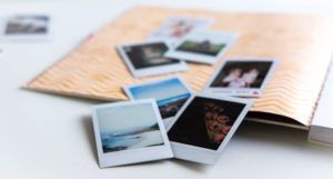 image of scattered Polaroid photos on an open scrapbook