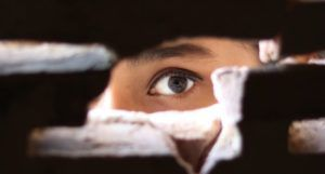 image of a person peeking through a hole https://www.pexels.com/photo/photo-of-person-peeking-through-the-hole-3820281/