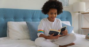 image of a young girl reading a book on a bed https://www.pexels.com/photo/black-girl-reading-book-on-bed-5063001/