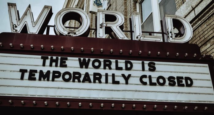 """image of a marquee sign that reads, """"The world is temporarily closed."""" https://unsplash.com/photos/Q8m8cLkryeo"""