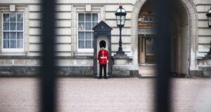 royal guard standing beyond the gates of buckingham palace