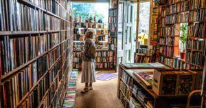 woman browsing books in bookstore