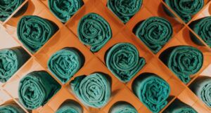 green towels in wooden diamond shaped cubbies