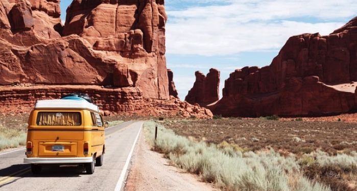 van on road in desert