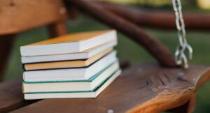 stack of books on bench