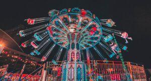 amusement park ride lit up at night
