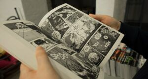 Image of an open manga between hands