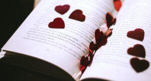 red metallic heart cutouts inside an open book