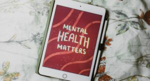 """Image of an ipad with art on it reading """"mental health matters."""""""