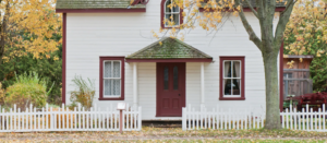 image of home and white picket fence by scott webb for unsplash