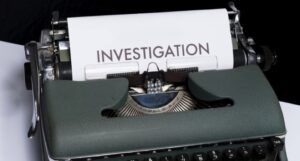 typewriter with a page reading investigation